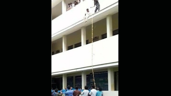 Logeswari was made to sit on the ledge of the second floor, while other students from the college waited below with a safety net.