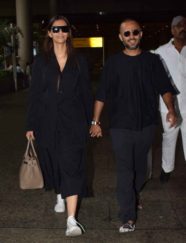 Sonam Kapoor and Anand Ahuja at the airport.