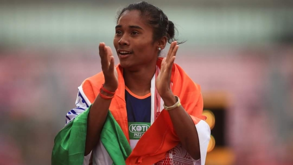 Hima Das celebrates with the Indian flag after winning her 400m Gold at the U-20 World Championships in Tampere, Finland
