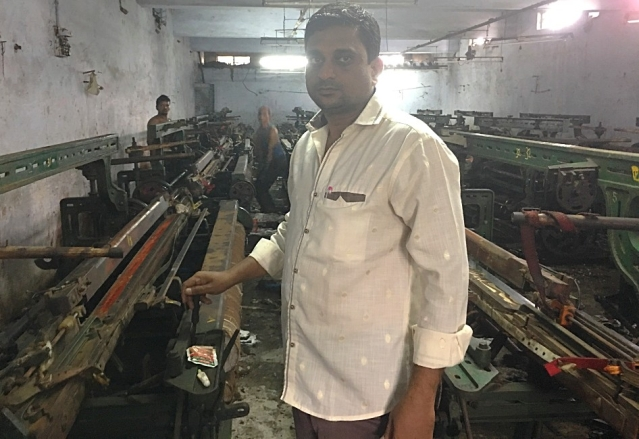 Munna Seth's looms are now locked up and rusting. He's unable to pay his workers or electricity bills.