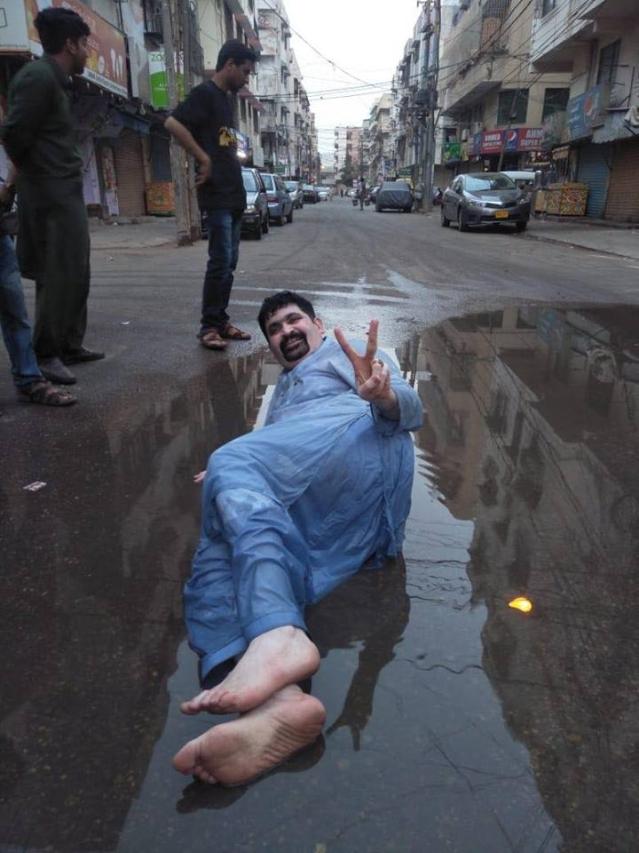 Motiwala lying down in sewage water.