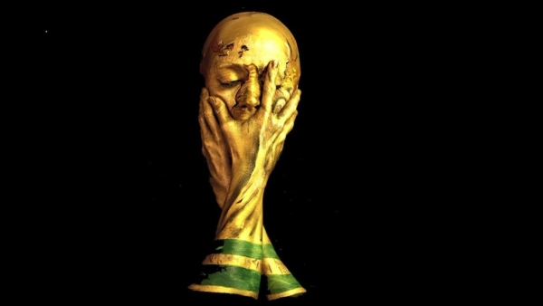Make-up artists Emma Allen transforms into the World Cup Trophy