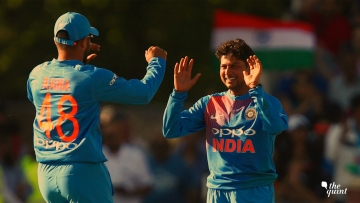 Kuldeep Yadav celebrates a wicket with Suresh Raina during the first T20I against England in Manchester on Tuesday.