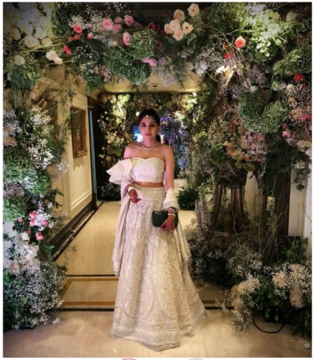 Dia Mehta Bhupal photographed against a beautiful floral backdrop.