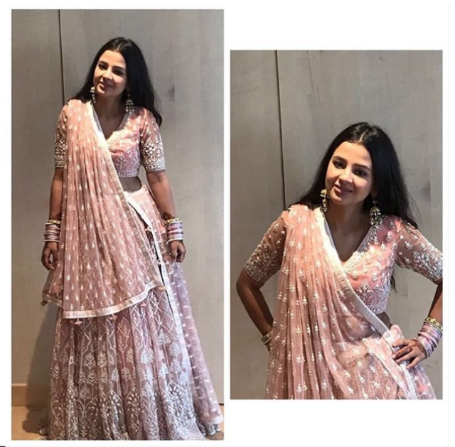 For the wedding, Sakshi wore an all over embroidered Anita Dongre lehenga for the wedding day.
