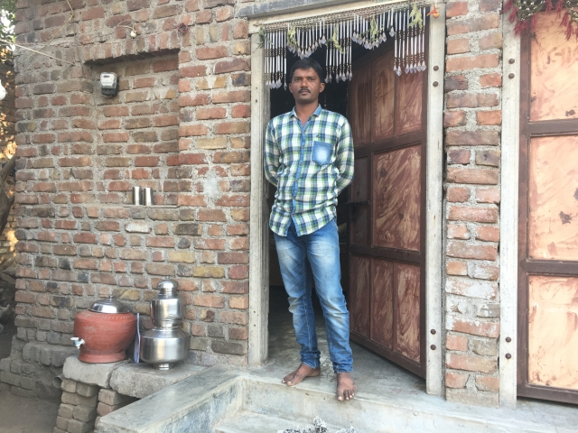 Ashish Dhansangh, a diamond worker, stands outside his house in Bhavnagar, Gujarat, India on 30 January, 2018.