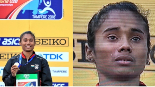 Hima Das wept on the top of the podium with her gold medal around her neck, singing the national anthem.