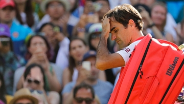 Roger Federer leaves the court after losing the quarter-final match against Kevin Anderson.