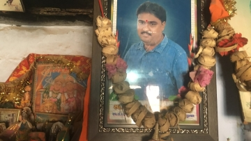 A picture of diamond polisher Bharatbhai Rathod who committed suicide last year hangs at his home in Damrala village in Bhavnagar, India, 31 January 2018.
