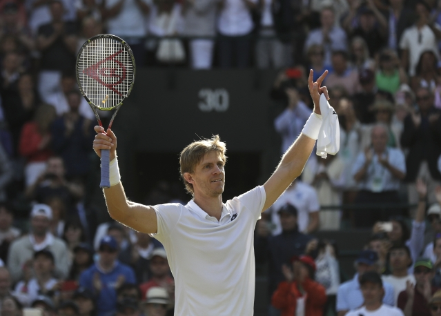 Kevin Anderson celebrates his victory over Roger Federer at Wimbledon.