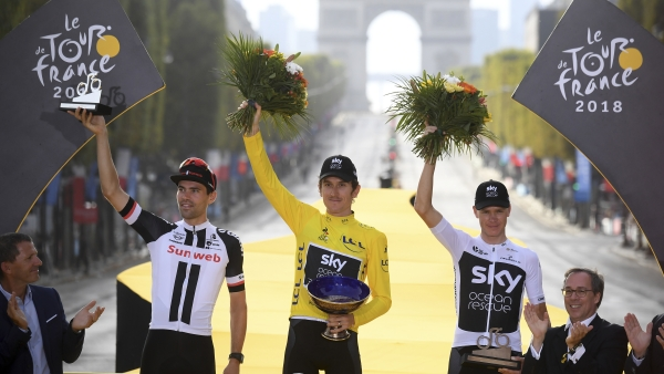Britain's Geraint Thomas, wearing the overall leader's yellow jersey, second place Netherlands' Tom Dumoulin, left, and third place Britain's Chris Froome, celebrate on the podium after the twenty-first stage of the Tour de France cycling race over 116 kilometers (72.1 miles) with start in Houilles and finish on Champs-Elysees avenue in Paris, France, Sunday July 29, 2018.