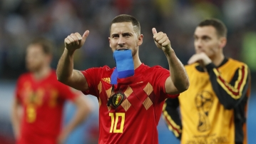 Belgium's Eden Hazard gestures to supporters after the semifinal match between France and Belgium at the 2018 FIFA World Cup in the St. Petersburg Stadium in, St. Petersburg, Russia, Tuesday, July 10, 2018.