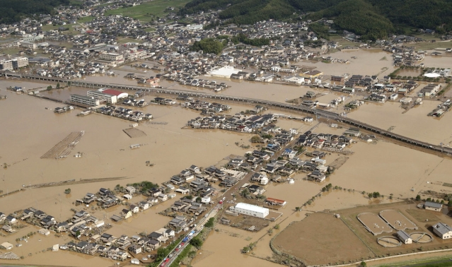 A submerged housing area in Kurashiki, Okayama prefecture, western Japan, on Monday, 9 July.