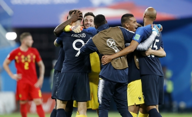France national soccer team players celebrate after winning the semifinal match between France and Belgium at the 2018 soccer World Cup in the St. Petersburg Stadium, in St. Petersburg, Russia