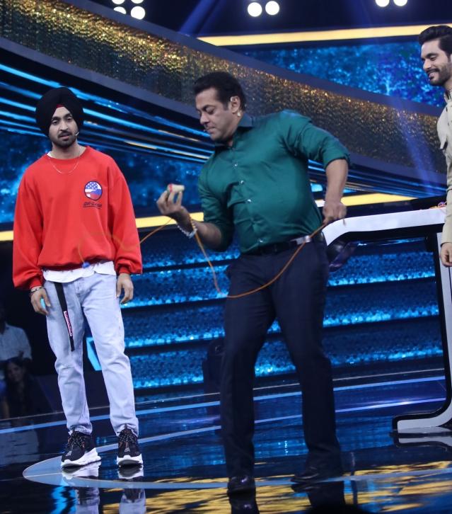 Salman Khan spins the top.