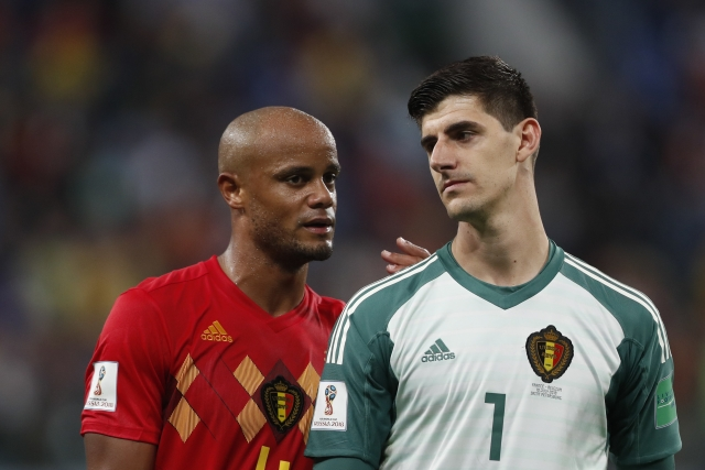 Belgium's Vincent Kompany, left, and Belgium goalkeeper Thibaut Courtois leave the field after the semifinal match between France and Belgium at the 2018 FIFA World Cup in the St. Petersburg Stadium in, St. Petersburg, Russia
