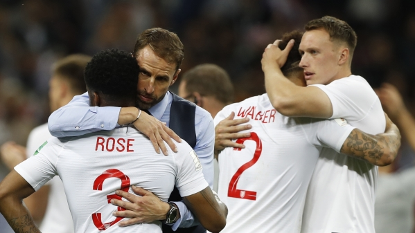 England head coach Gareth Southgate, 2nd left, comforts England's Danny Rose, left, after loosing the semifinal match between Croatia and England at the 2018 soccer World Cup in the Luzhniki Stadium in Moscow, Russia, Wednesday, July 11, 2018.