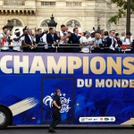 France's players celebrate on the roof of a bus while parading down the Champs-Elysee avenue in Paris.