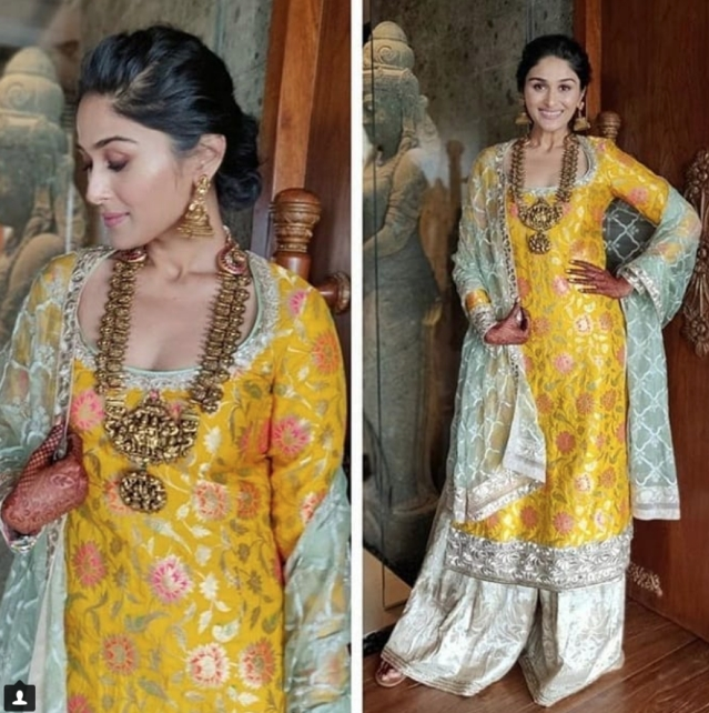 Poorna chose a mango yellow lehenga featuring mirror work for the <i>mehendi</i>.