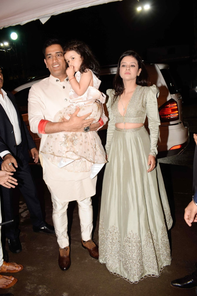 Sakshi Singh Dhoni along with husband, MS Dhoni and daughter, Ziva at Poorna Patel's wedding reception.