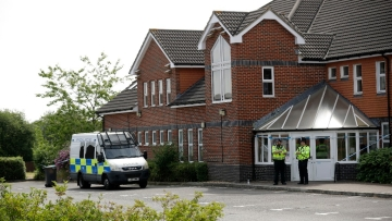 British police officers guard a cordon outside the Amesbury Baptist Centre church in Amesbury, England, on 4 July.