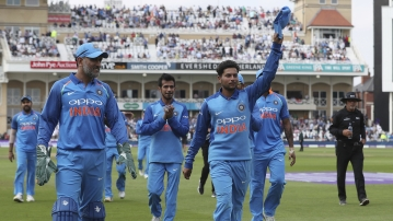 Kuldeep Yadav leads the Indian team off the field after finishing with a haul of 6/2 against England.