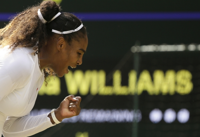 Serena Williams of the United States celebrates winning a point during her women's singles match against Russia's Evgeniya Rodina, on day seven of the Wimbledon Tennis Championships, in London, Monday July 9, 2018.