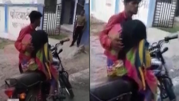 Son carries his deceased mother's body on a bike in MP's Tikamgarh.