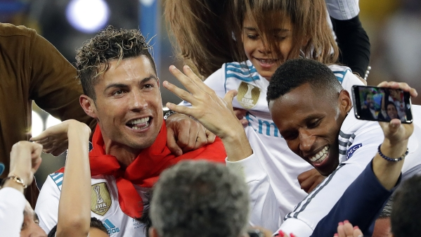 In this Saturday, May 26, 2018 file photo Cristiano Ronaldo celebrates with family after winning the Champions League Final match between Real Madrid and Liverpool at the Olimpiyskiy Stadium in Kiev, Ukraine.