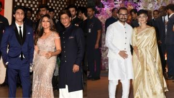 Aryan, Gauri and Shah Rukh Khan; Aamir Khan with Kiran Rao at the Ambani party.