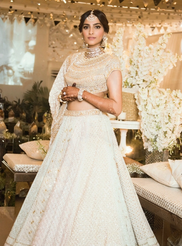 The bride wore a multi-panelled <i>lehenga</i> to her <i>Mehendi-Sangeet</i> that took Abu Jani & Sandeep Khosla's team 18 months to create!