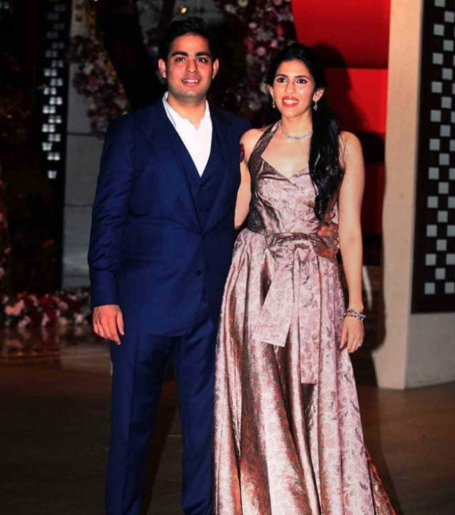 Shloka wore a custom made brocade Prada dress, while Akash wore a blue suit at the pre-engagement bash.