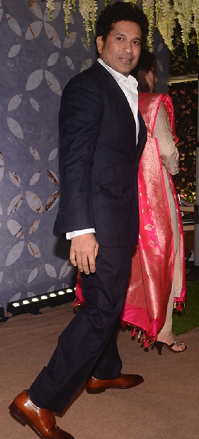 Sachin Tendulkar walks in for the reception in Mumbai.