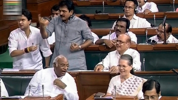 UPA Chairperson Sonia Gandhi, Mallikarjun Kharge and other Congress members in the Lok Sabha during the Monsoon session of Parliament on 19 July.