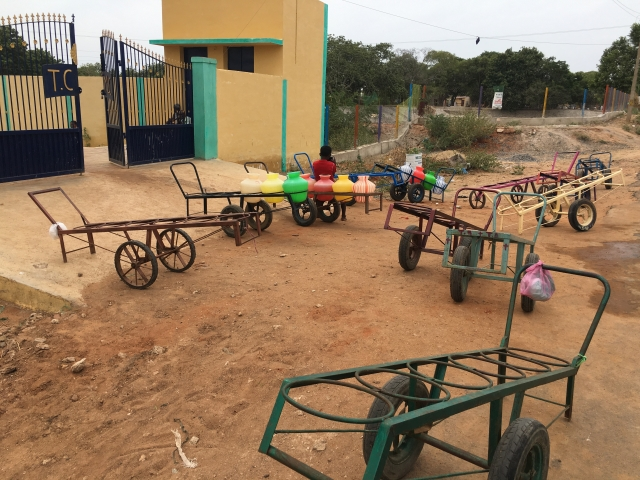 Trolleys with colourful drums is a common sight in the villages.