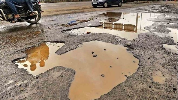 Representative photo of a pothole.