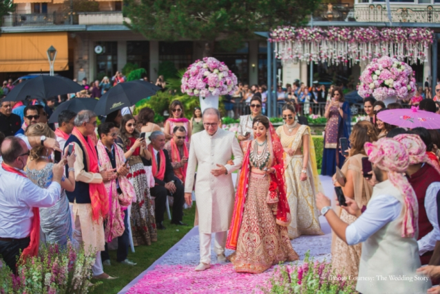 When the father walks the bride towards the mandap!