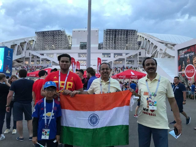 Dr Saha and Dr Sarkar from Kolkata wanted to pose with our flag inside the Fisht Stadium.