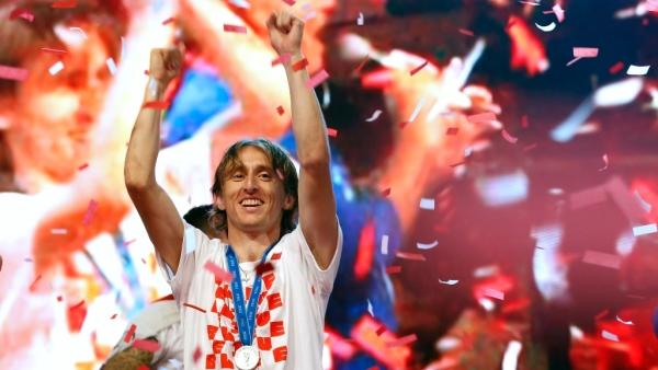 Croatia's Luka Modric celebrates upon their arrival in Zagreb, Croatia.