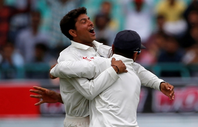 Kuldeep Yadav and Murali Vijay celebrate the dismissal of Australia's Peter Handscomb in the former's first Test match.