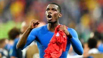 France's Paul Pogba celebrates after his team advanced to the final after the semifinal match between France and Belgium at the 2018 soccer World Cup in the St. Petersburg Stadium in St. Petersburg, Russia, Tuesday, July 10, 2018.