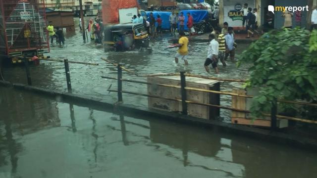 Commuter wades through water at Nallasopara.