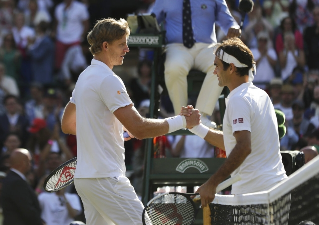 Kevin Anderson shakes hands with Roger Federer at the end of their Wimbledon quarter-final match.