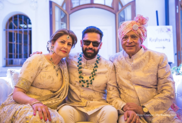 Rajiv photographed with his parents.