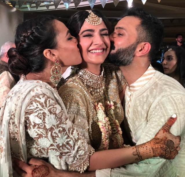 BFF Swara Bhasker and groom, Anand Ahuja kiss the bride! Don't miss the cute elephant mehendi design on the groom's hand!