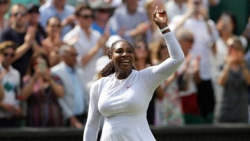 Serena Williams of the United States celebrates defeating Germany's Julia Gorges in their women's singles semifinals match at the Wimbledon Tennis Championships, in London, Thursday July 12, 2018.