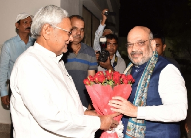 Patna: Bihar Chief Minister Nitish Kumar greets BJP Chief Amit Shah during a dinner party at his official residence in Patna on July 12, 2018. (Photo: IANS)
