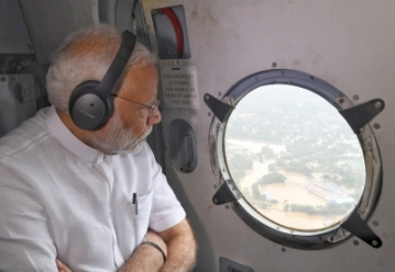 Kerala: Prime Minister Narendra Modi conducts an aerial survey of flood affected areas, in Kerala on Aug 18, 2018. (Photo: IANS/PIB)