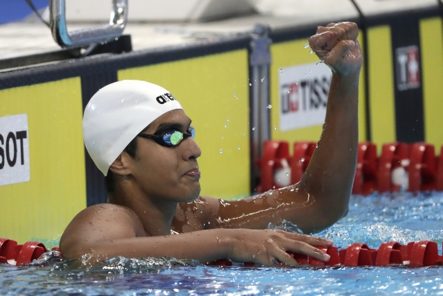 India's Srihari Nataraj reacts after winning Heat 1 of the men's 100m backstroke during swimming competition at the 18th Asian Games in Jakarta, Indonesia, Sunday, Aug. 19, 2018.