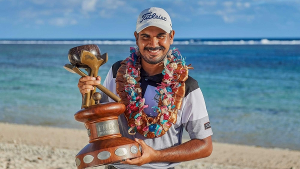 Indian golfer Gaganjeet Bhullar poses with the trophy after winning his maiden European Tour title with a brilliant chip-in eagle on the 17th hole for a one-stroke win over Australia's  Anthony Quayle during the Fiji International Golf at The Intercontinental Gold Club in Fiji on Sunday.